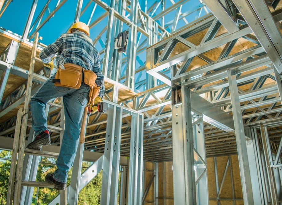 Worker on a ladder. Builder's Risk