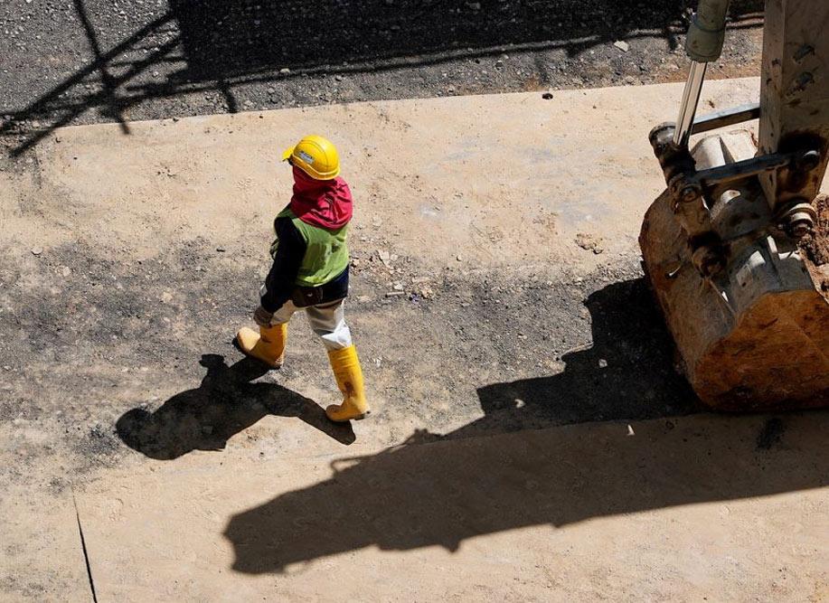 Worker walking. Building insurance