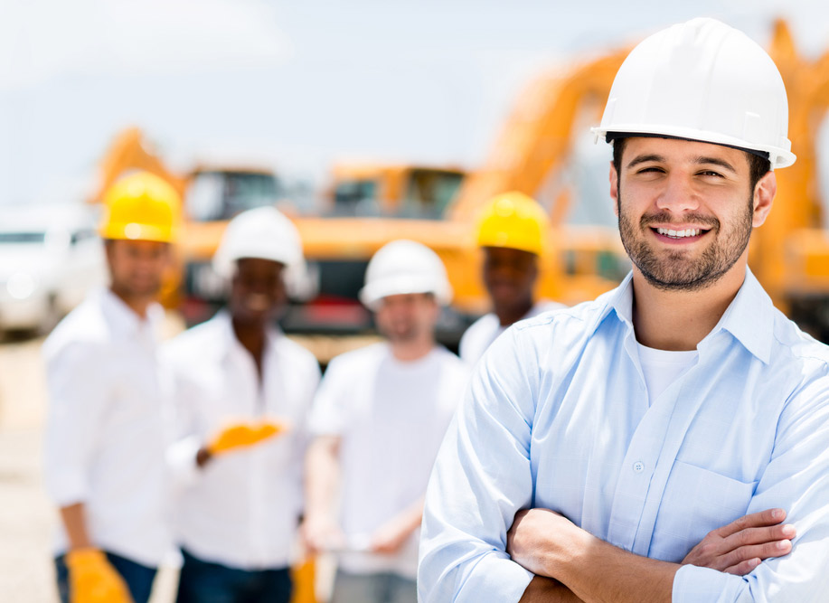 Smiley construction worker with company behind
